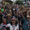 Tourists attracted to party atmosphere at demonstration sites in Bangkok
