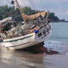 Storm beaches yacht on Phuket's Kata Beach