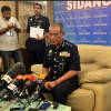 Malaysia arrests eight suspects helping to smuggle bomb suspects to Malaysia