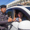 Kathu officials hand out nasal inhalers to promote driving alertness in Phuket New Years traffic