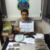 Phuket Police seize 11 kilos of brick weed, other items from 22-year-old pot dealer