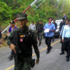 Armed negotiations re-open road to Phuket beach