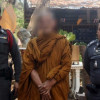 Fake monk with porno mag and orange car arrested