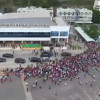 Thousands of Myanmar migrant workers show up to welcome Suu Kyi