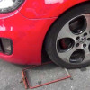 Malaysian driver acts dumb as he replaces clamped wheel with the spare