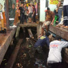 Walkway collapse at market dumps tourists in the water