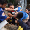 Thai boy survives after his NECK becomes impaled on a spike while climbing over a gate