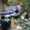 Chinese tourists drive off the hillside after renting car at the airport