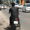 Tourists in Samui fined for not wearing motorbike helmets by a fake policeman