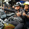 Governor joins Phuket Bike Week helmet giveaway awareness campaign
