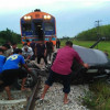 Driver dead as pick-up dragged 200 meters by Bangkok bound train
