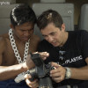 """A foreign photographer gets support from Muay Thai superstar Buakaw to buy recycle paper bags  for every 7-Eleven"""