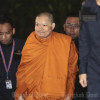 Jet-setting monk back in Bangkok to face charges