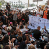 Crowds gather at Bangkok's Democracy Monument to demand election