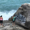 Everyone's angry as graffiti spray painted on large rock at Samui scenic point