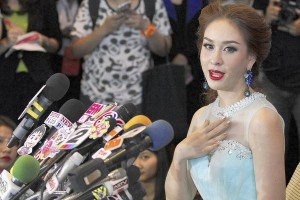 Miss Universe Thailand Weluree Ditsayabut, 22, speaks during a news conference at Renaissance Hotel in Bangkok