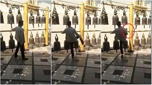 Chinese kicks bell in Thai temple