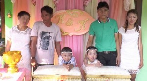four year old twins get married in Thailand