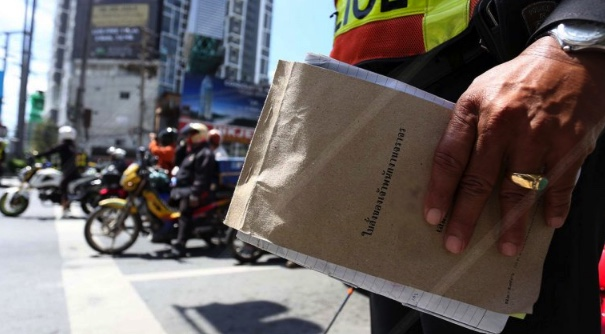 Tickets for traffic violations are being printed in English to welcome in the Asean Economic Community   Samui Times