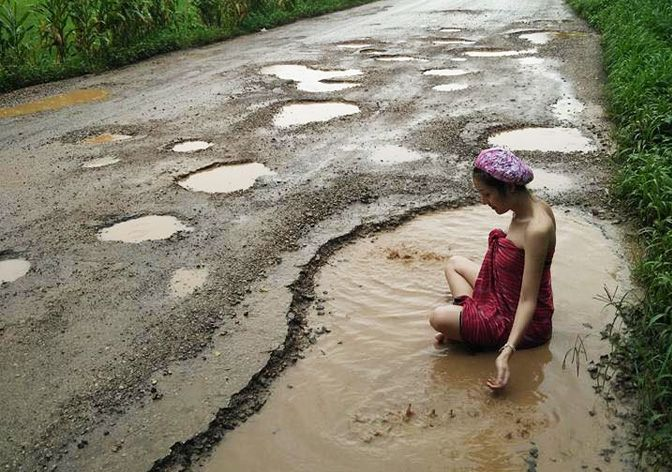 Thai woman takes bath in pothole to protest bad condition of her hometown's roads | Samui Times