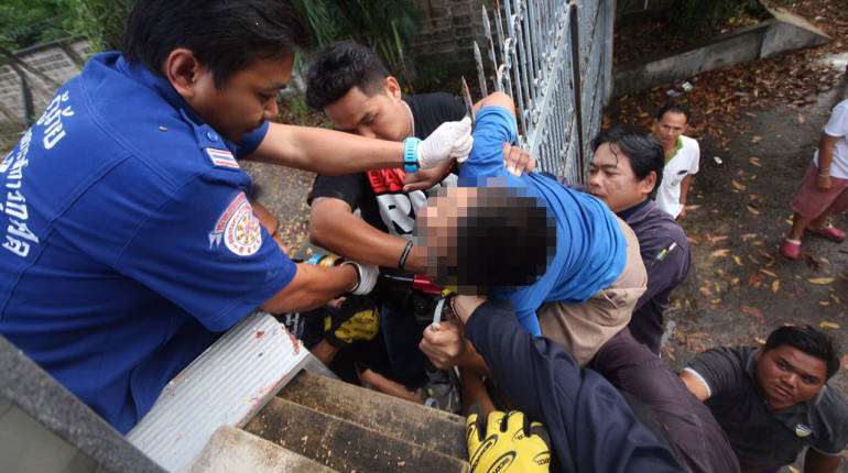 Thai boy survives after his NECK becomes impaled on a spike while climbing over a gate | Samui Times