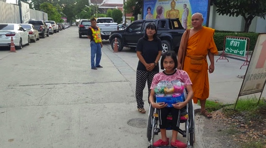 Girl in a wheelchair has been conned out of 5 million baht by bent lawyer, says mum   Samui Times