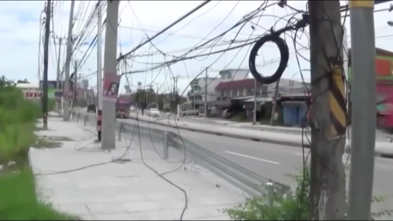 Chonburi residents call in the media to get action from a particularly nasty stretch of hanging wires | Samui Times