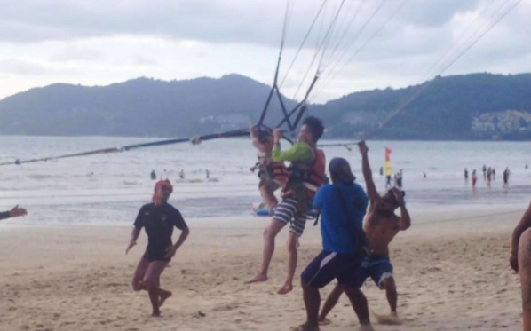 Terrified two year old toddler forced to go paragliding in Phuket | Samui Times