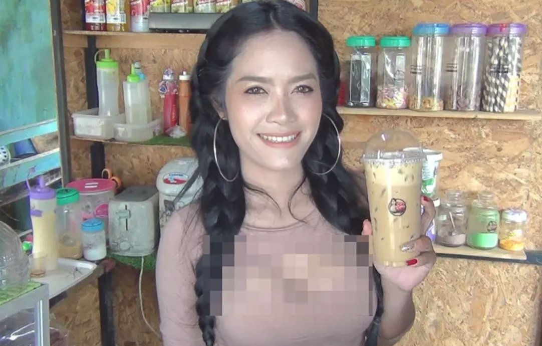 """Male customers queuing up for busty Khwan's """"jugs"""" of milk 
